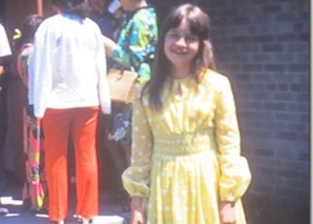 Even Sue had to wear a ridiculous graduation dress...